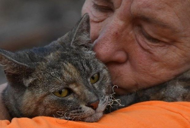 Reunited with her family after surviving a wildfire.